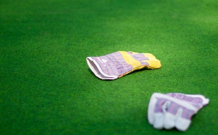 Gloves Lying on Turf